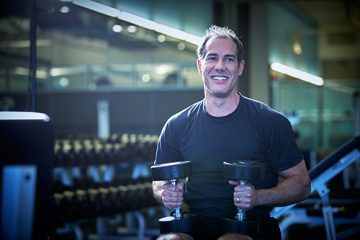 Amazing Patient Tim Sweeney working out in the gym