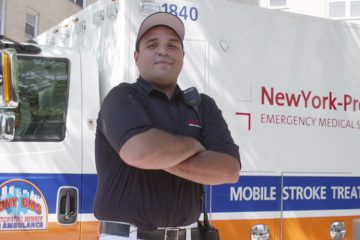 A healthcare provider outside a mobile stroke unit