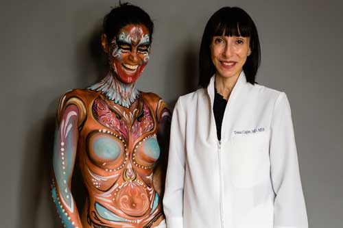 A portrait of a woman in face and body paint alongside oncologist Dr. Tessa Cigler