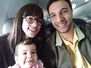 Portrait of Nathan Santacruz with his wife and daughter