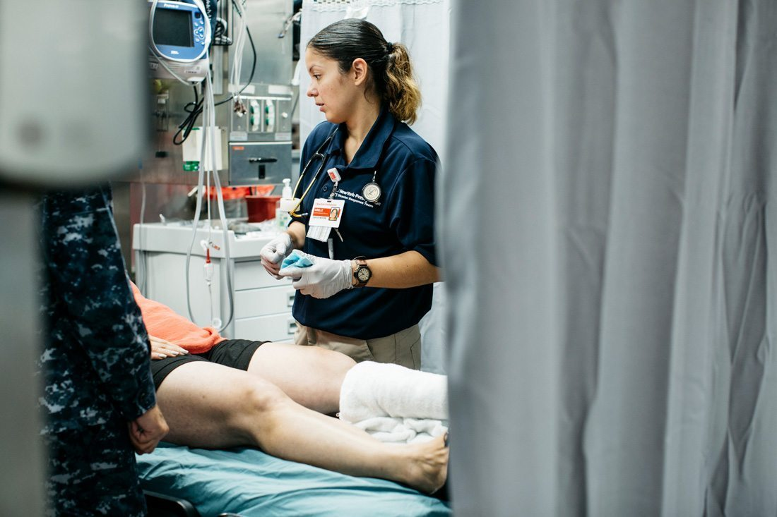 A clinical nurse treating a patient in Puerto Rico