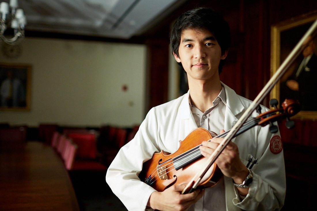 Portrait of Peter Hung with his violin