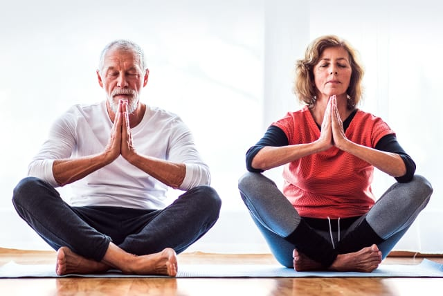 A couple in a yoga pose