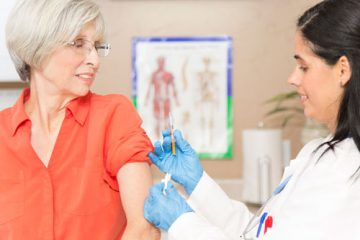 A woman receiving a shot in the arm