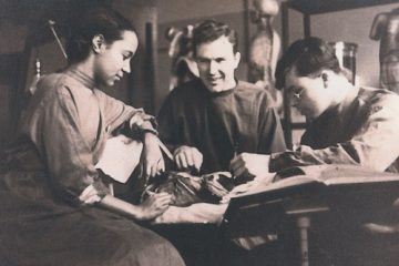 Photo of three young doctors with a patient