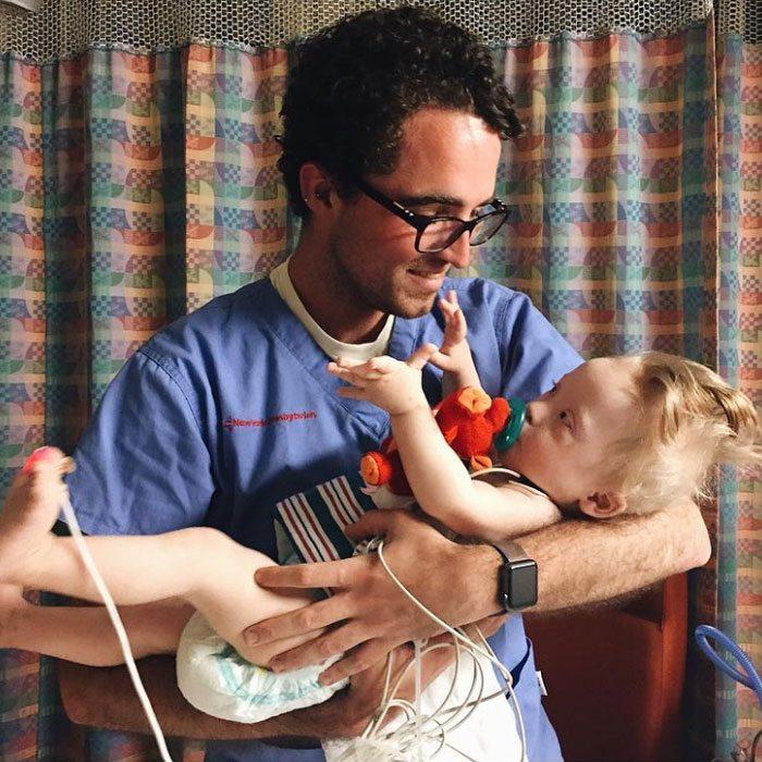 Nurse Samuel Taylor-D'Ambrosio cradling Dashiel