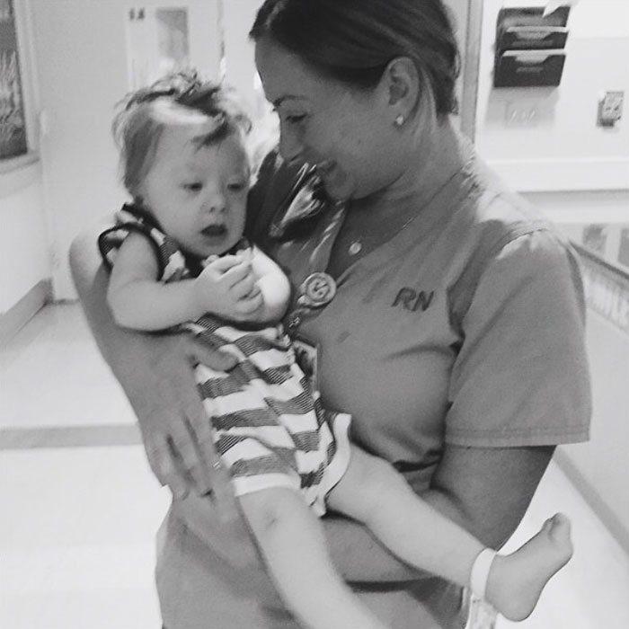 Nurse Tricia Budway cradling Dashiel