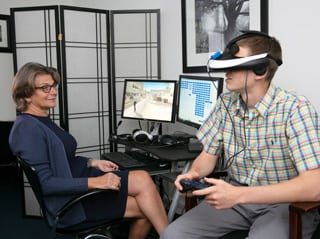 Dr. Difede using virtual reality exposure therapy to treat a patient