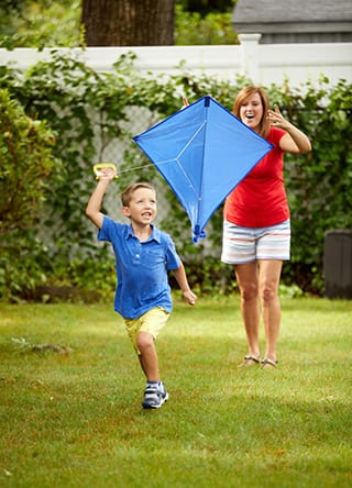 Cynthia Vander Molen flying a kite with son Jack