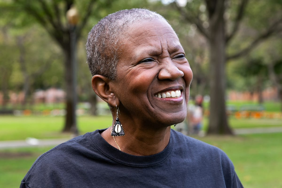 A woman smiling in a park