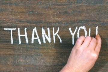 "The words ""thank you"" written on a chalkboard"