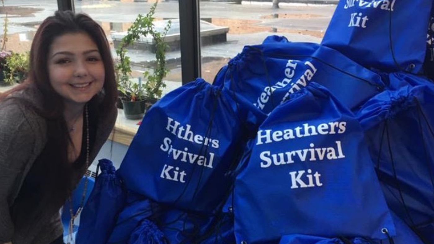 Amazing Patient Heather McNamara posting with gift bags for pediatric patients