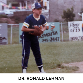 Dr. Ronald Lehman playing baseball as a child