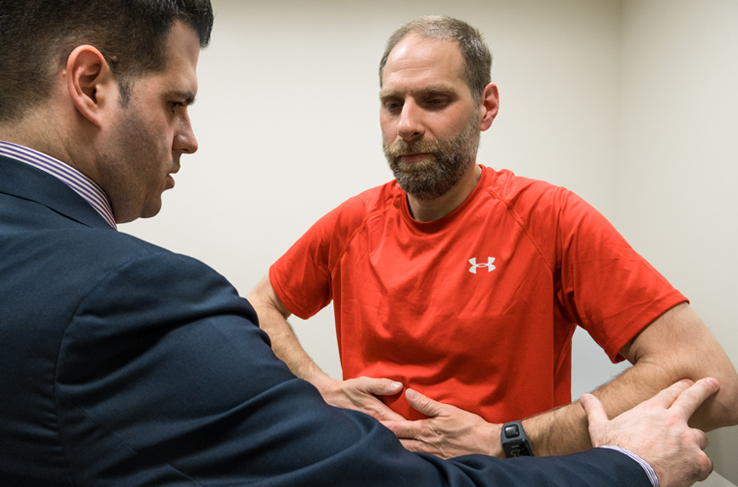 A man being evaluated by a healthcare provider