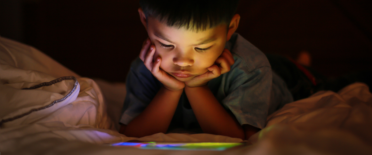Young boy looking at a screen
