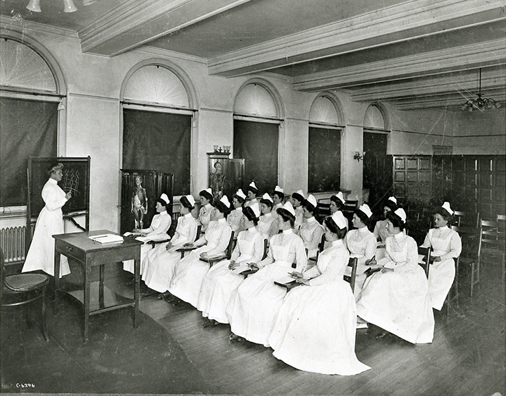 Photo of Anna Maxwell in classroom with nursing students.