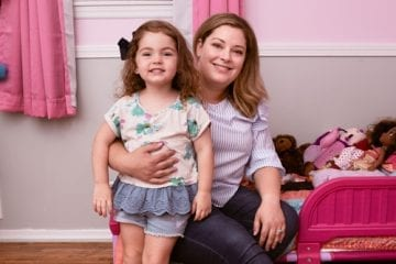 Kristin McKinley at home with daughter Emma. Kristin learned she had acute myeloid leukemia while pregnant with Emma.