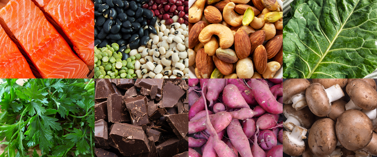 Image of various whole foods including fish, veggies, nuts, herbs and chocolate