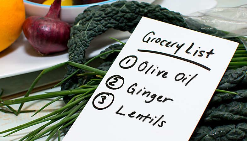 Grocery list listing olive oil, ginger, and lentils–3 doctor-approved kitchen staples.