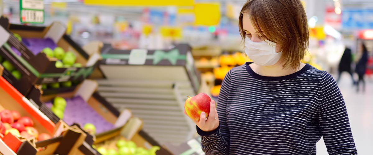 woman grocery shopping during COVID-19 pandemic