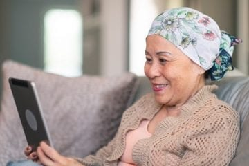 woman with cancer doing a telemedicine visit due to COVID-19 restrictions