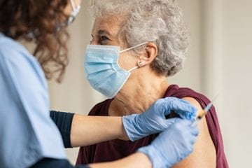 Woman gets COVID-19 vaccine